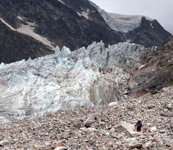 Glacier and hiker on moraine Stock photo © BSANI