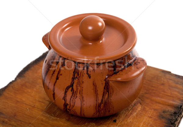 Dirty ceramic pot on old wooden kitchen board Stock photo © BSANI