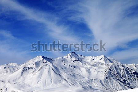 Winter snowy mountains at windy day Stock photo © BSANI