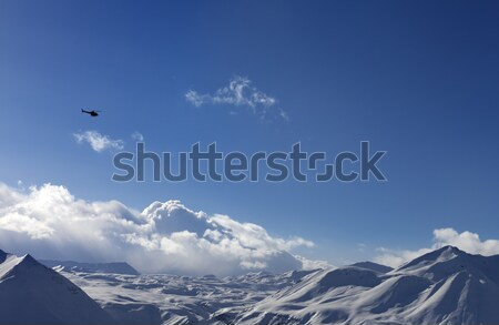 Helicopter above snowy plateau in evening Stock photo © BSANI
