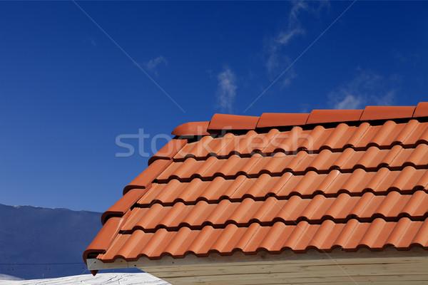 Roof tiles against ski slope in nice day Stock photo © BSANI