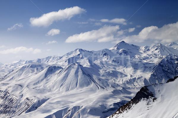 Snowy winter mountains in sun day Stock photo © BSANI