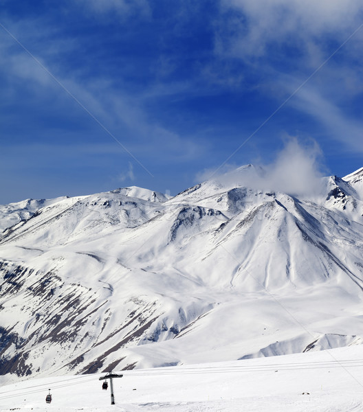 Stock photo: Winter snowy mountains and ski slope at sun day
