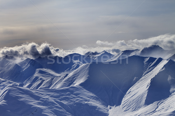 Snowy mountains at winter evening Stock photo © BSANI
