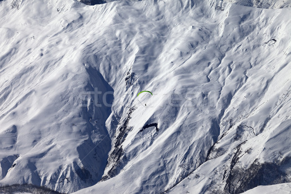 Speed flying in winter mountains in sun nice day Stock photo © BSANI