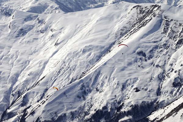 Paragliders of snowy mountains Stock photo © BSANI