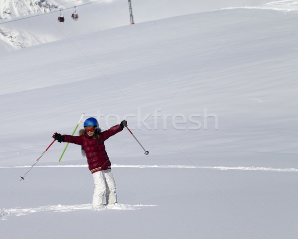 Happy girl on off-piste slope after snowfall at nice sun day Stock photo © BSANI