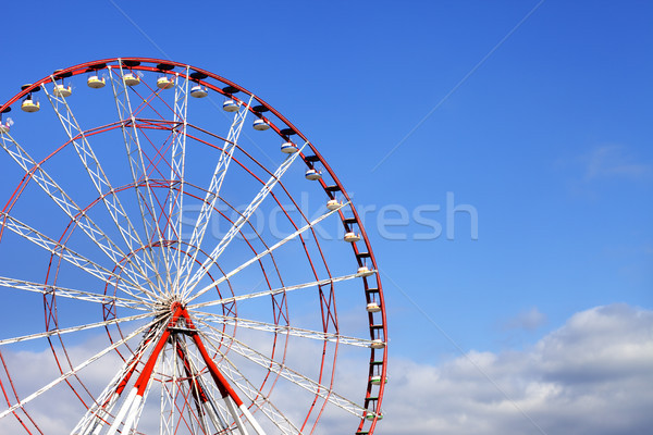 Ferris wheel and blue sky with clouds Stock photo © BSANI