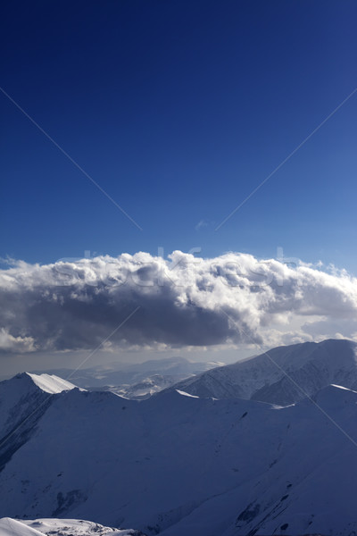 Snow mountains and blue sky. View from ski slope. Stock photo © BSANI