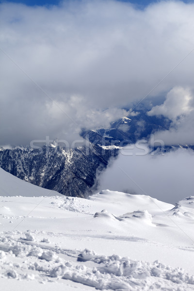 View on winter snowy mountains in clouds Stock photo © BSANI