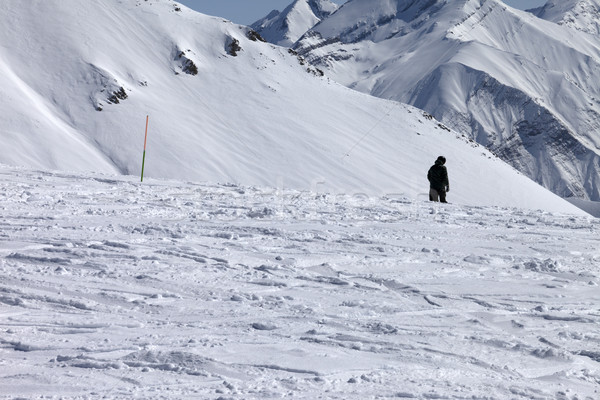 Stock photo: Ski trail and snowboarder in sun nice day