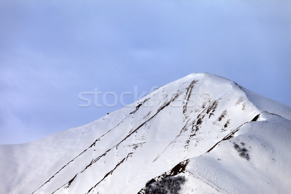Off-piste snowy slope in morning Stock photo © BSANI