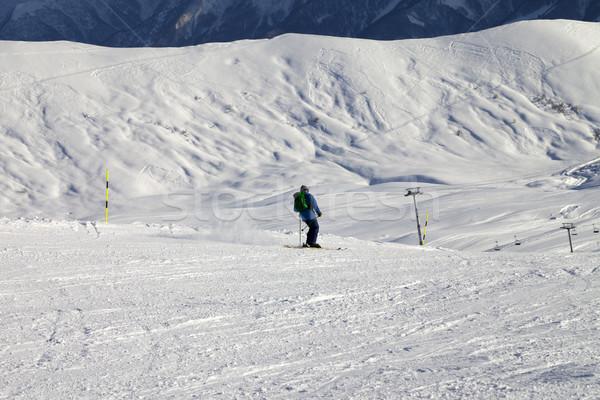 Esquiador sol noite cáucaso montanhas Foto stock © BSANI