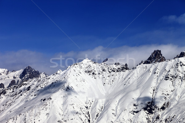 View on snowy mountains in haze at sunny day Stock photo © BSANI