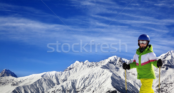 Young skier with on snow mountains at sun winter day Stock photo © BSANI