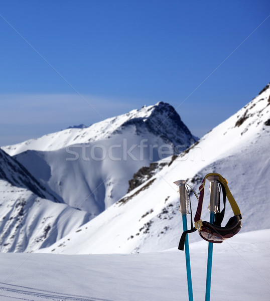 Stock photo: Ski mask on ski poles and off-piste slope