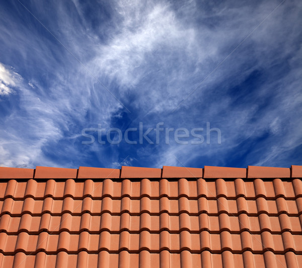 Roof tiles and sky with clouds at sun day Stock photo © BSANI