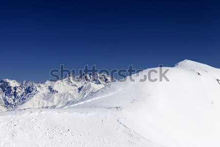 Snowboarders and skiers downhill on off piste slope Stock photo © BSANI