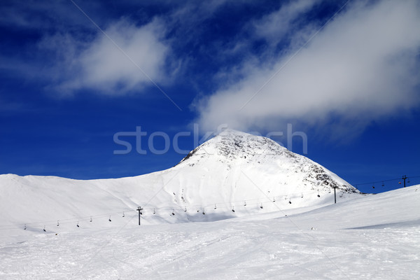Chair-lift and ski slope at sun wind day Stock photo © BSANI