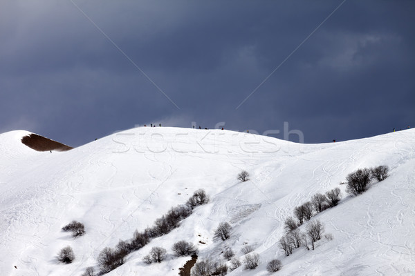 Stock photo: Off piste slope and overcast sky in windy day
