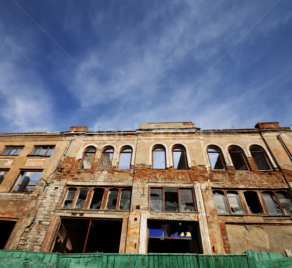 Facade of old destroyed house. Wide-angle view. Stock photo © BSANI
