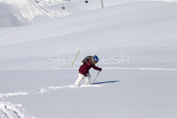 Little skier on off-piste slope with new fallen snow at sun day Stock photo © BSANI