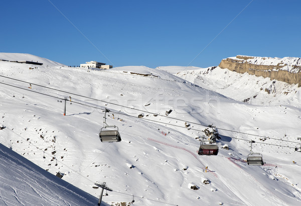 Stock photo: Ski slope and chair-lift at sun day