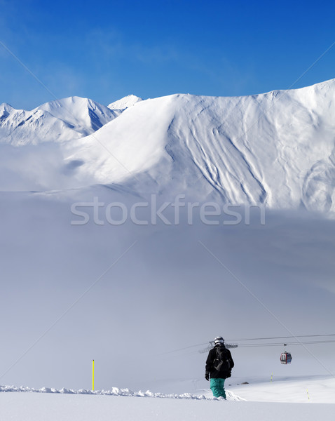 Snowbordos emelkedő hegyek köd Kaukázus Grúzia Stock fotó © BSANI