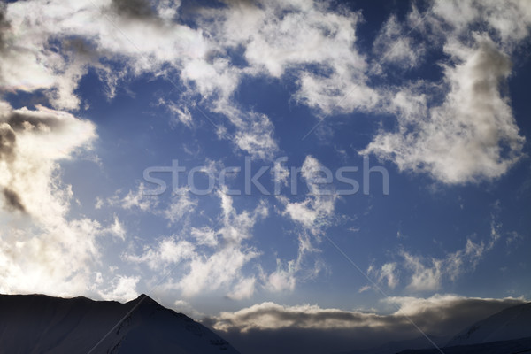 Blue sky with clouds and mountains in evening Stock photo © BSANI
