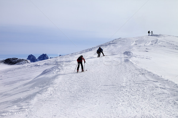 Skiers on ski slope at wind day Stock photo © BSANI