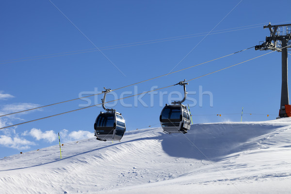 Gondola lift on ski resort at windy sun day Stock photo © BSANI