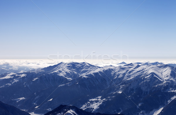 Snowy mountains in morning haze Stock photo © BSANI