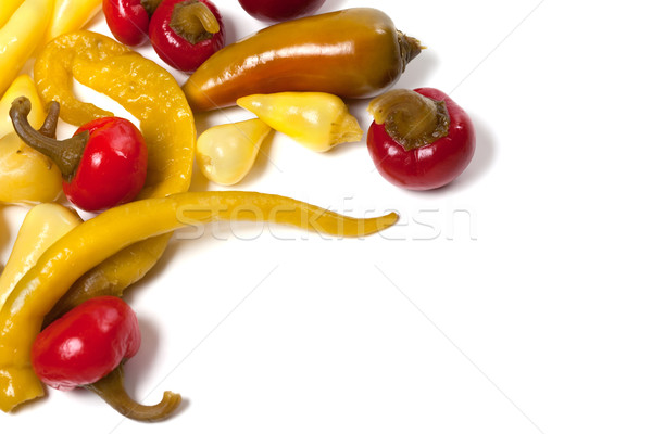 Stock photo: Mix of hot pickled peppers isolated on white background