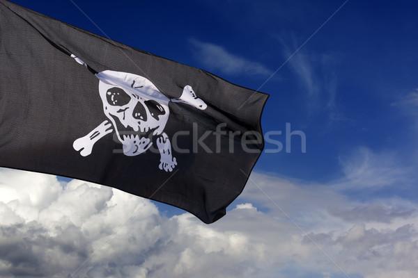 Pirate pavillon ciel bleu nuages croix Photo stock © BSANI
