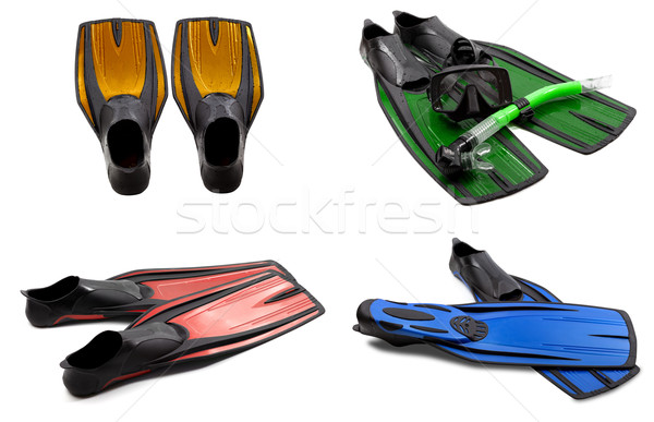 Set of multicolored swim fins, mask, snorkel for diving with wat Stock photo © BSANI