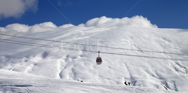 Panoramic view on gondola lift and ski slope at sun day Stock photo © BSANI