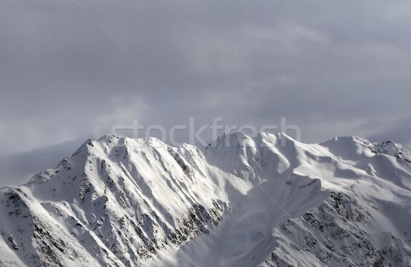 Noite luz solar montanhas cinza céu cáucaso Foto stock © BSANI