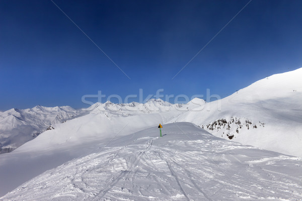 Warning sing on ski slope and snowy mountains in sun day Stock photo © BSANI