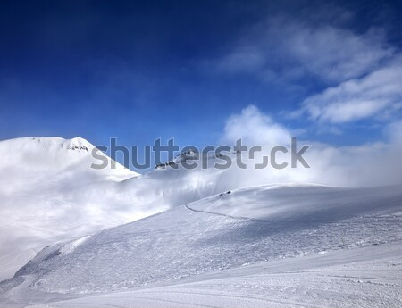 Off-piste slope with traces of skis Stock photo © BSANI
