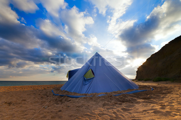 Conical tent on summer beach and blue sky with clouds Stock photo © BSANI
