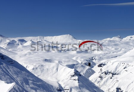 Sky gliding in snowy mountains at nice sun day Stock photo © BSANI