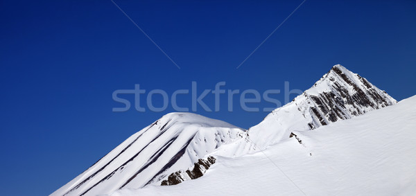 Panoramic view on off-piste slope and blue clear sky in nice day Stock photo © BSANI