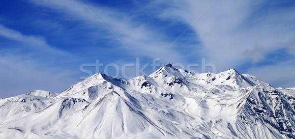 Panoramic view on winter snowy mountains in windy day Stock photo © BSANI