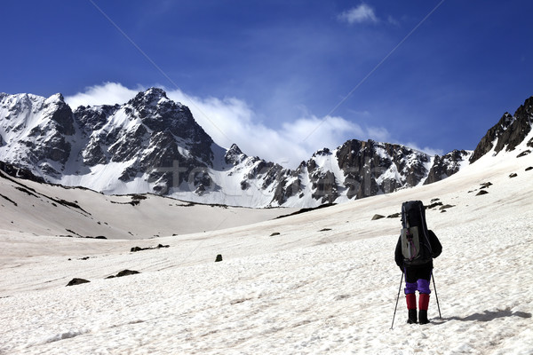 Hiker on snow plateau at spring mountain. Stock photo © BSANI