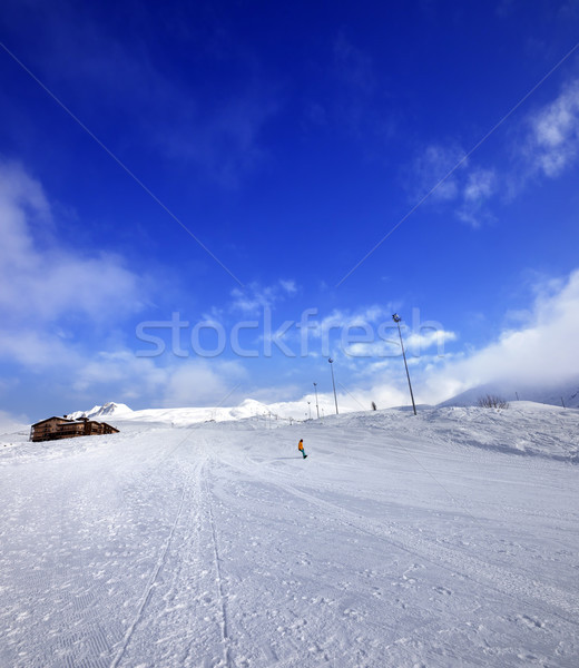 Snowboarder on ski slope in nice sun day Stock photo © BSANI