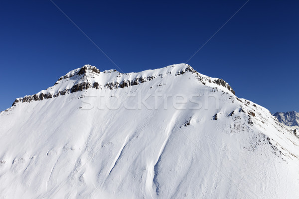 Snowy rocks in sun day Stock photo © BSANI