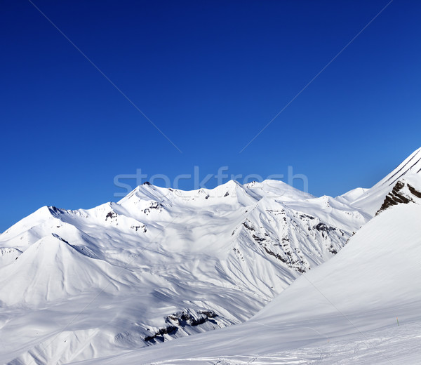 View on ski slope and beautiful mountains at sun day Stock photo © BSANI