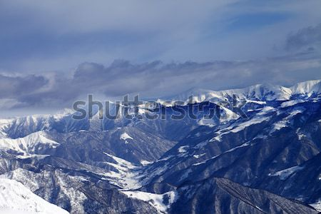 Winter mountains at nice sunny day. Caucasus Mountains. Stock photo © BSANI