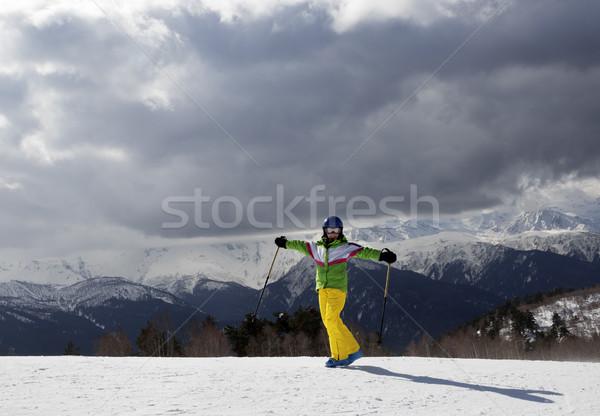 Mutlu genç kayakçı Kayak güneş dağlar Stok fotoğraf © BSANI