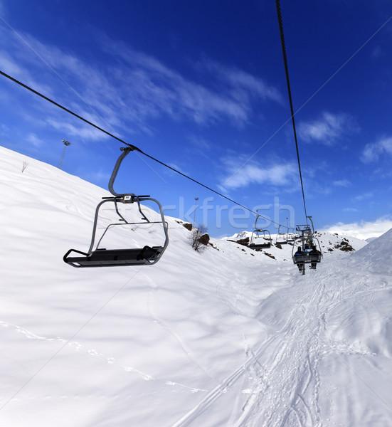 Chair-lift at ski resort in sun winter day Stock photo © BSANI